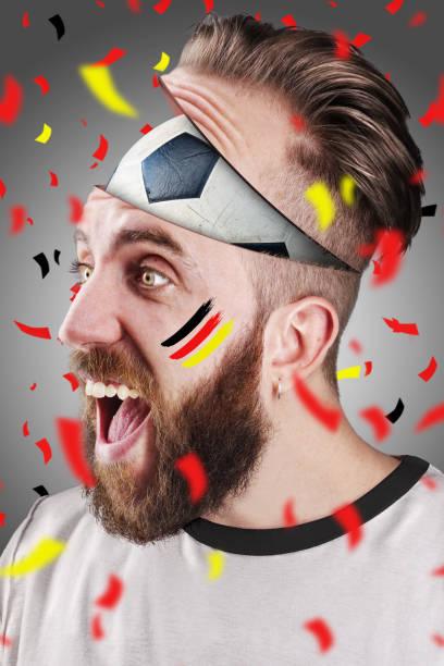 German soccer fan with football inside the head - foto stock