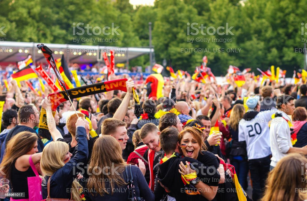 German soccer fans celebrating goal on public viewing event stock photo