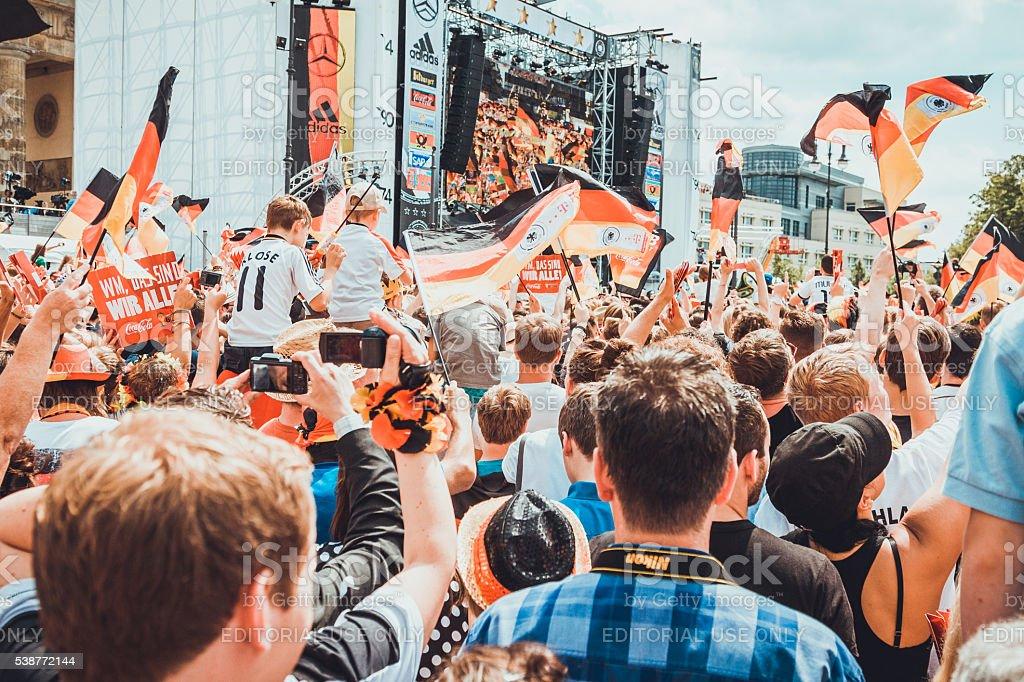 German soccer fans celebrating winning of World Cup in Berlin. stock photo