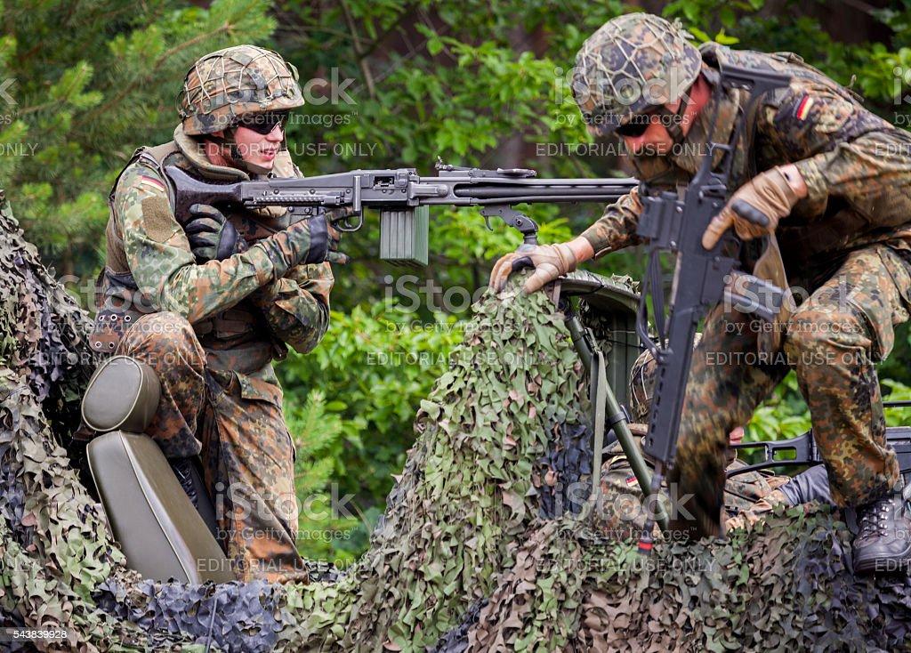 german soldier fires with machine gun stock photo