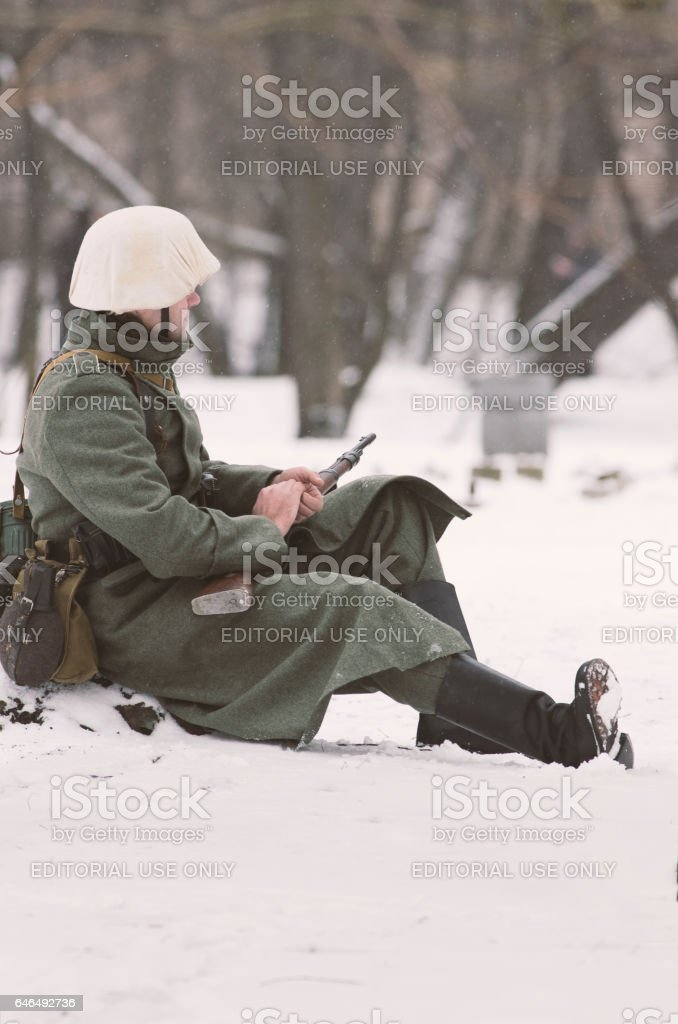 A German soldier warming his hands in anticipation. stock photo