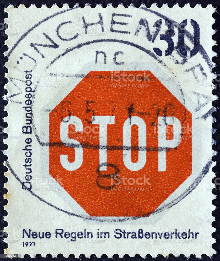 German stamp shows 'stop' sign (1971) royalty-free stock photo