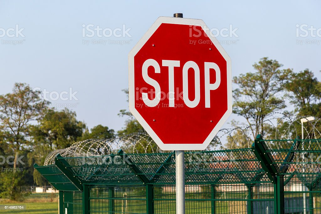 German Stop Sign On Barb Wire Fence Stock Photo & More Pictures of ...