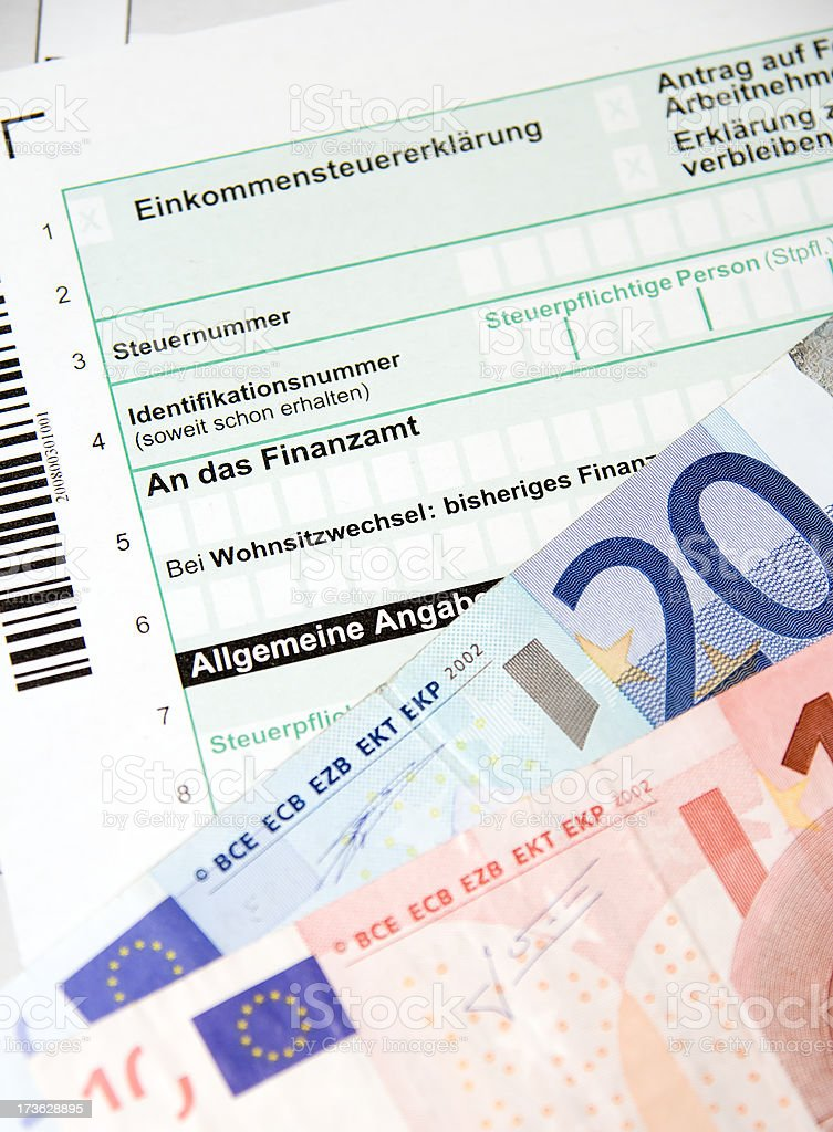 German Tax Form with Euro banknotes royalty-free stock photo