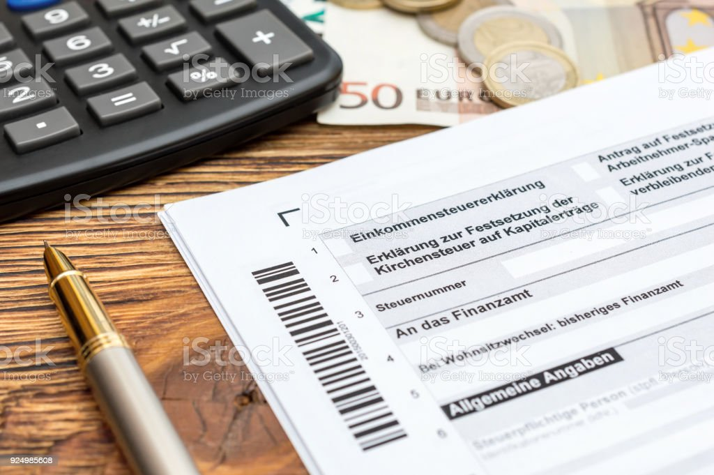 german tax form with penmoney and calculator on the table close up