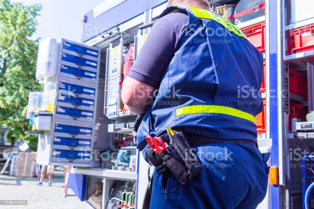German technical emergency service man on an equipment truck man