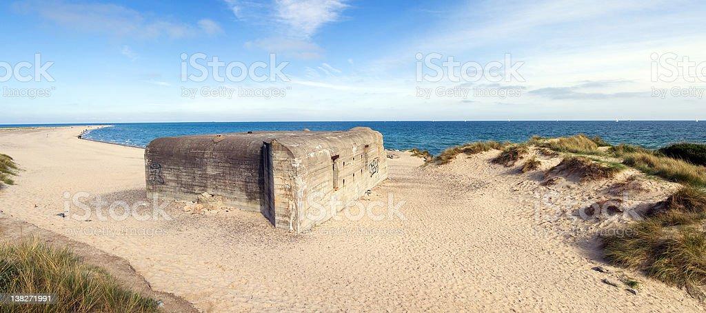 German war bunker on beach by sea royalty-free stock photo
