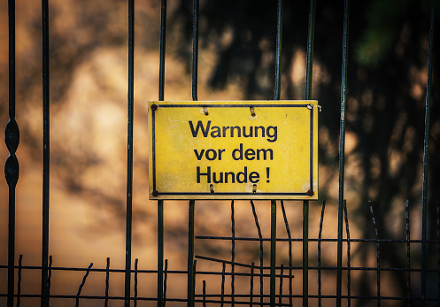 German warning sign hanging on the fence