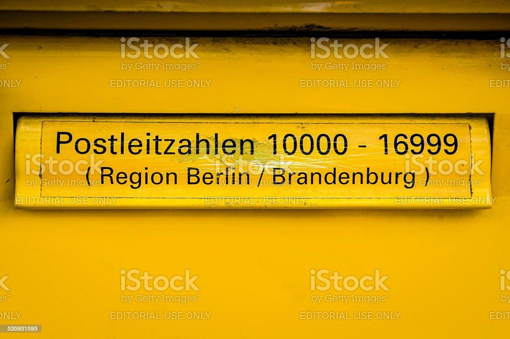 German Yellow Mail Box in Berlin stock photo