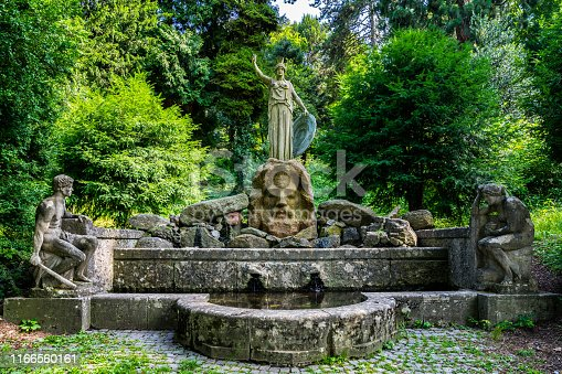 istock Germany, Ancient famous spring called athenenbrunnen with sculptures of zeus, prometheus and pandora in public park of stuttgart city near karslhoehe 1166560161