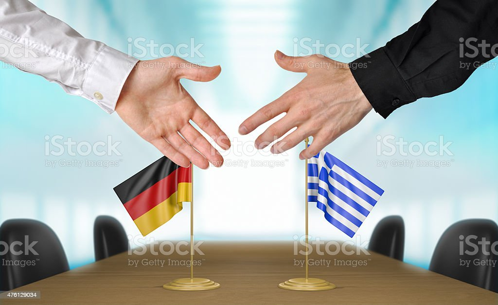 Germany and Greece diplomats agreeing on a deal stock photo