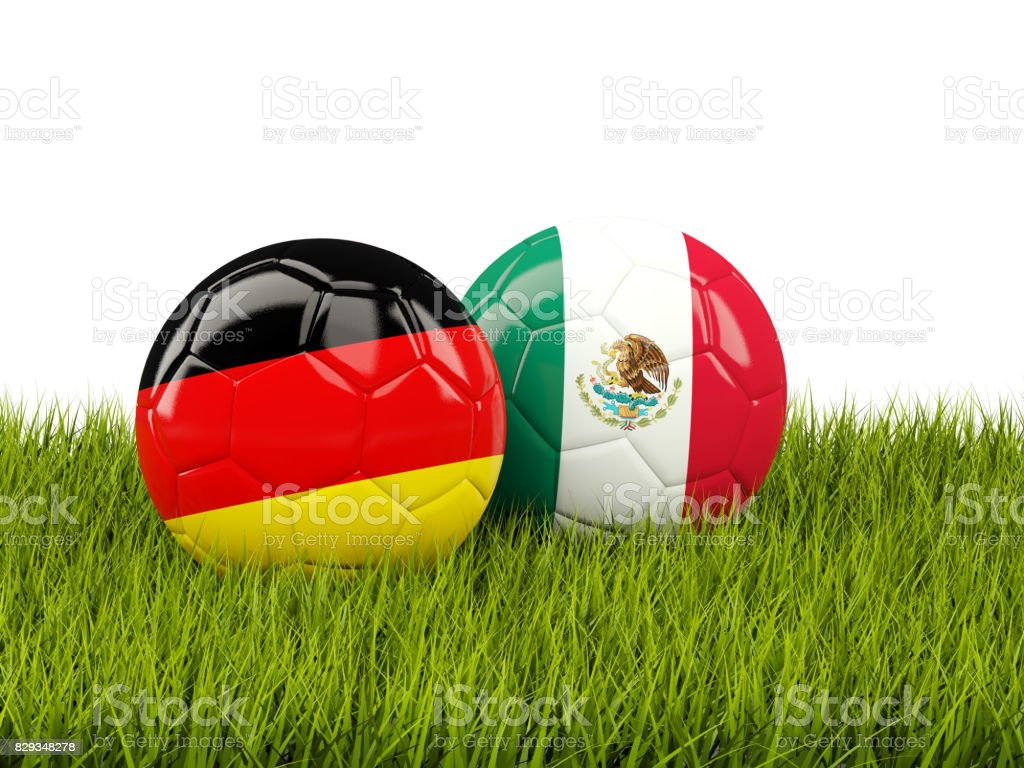 Germany and Mexico soccer balls on grass stock photo