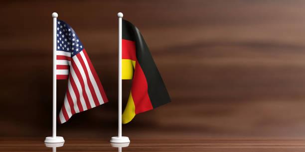 deutschland und usa flaggen auf hölzernen hintergrund. 3d illustration - deutschland usa stock-fotos und bilder