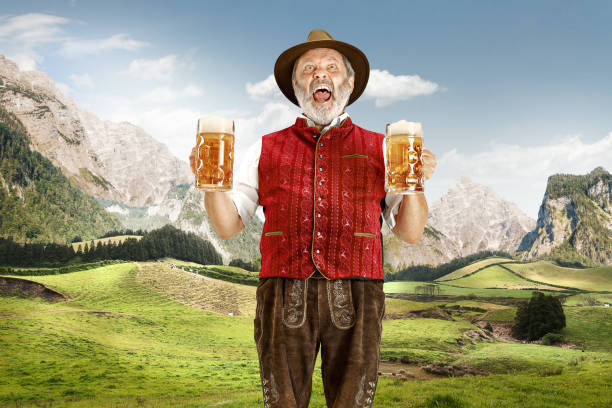 germany, bavaria, upper bavaria, man with beer dressed in traditional austrian or bavarian costume - baviera foto e immagini stock