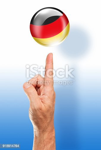 istock Germany button german flag pointing with human hand 915914764