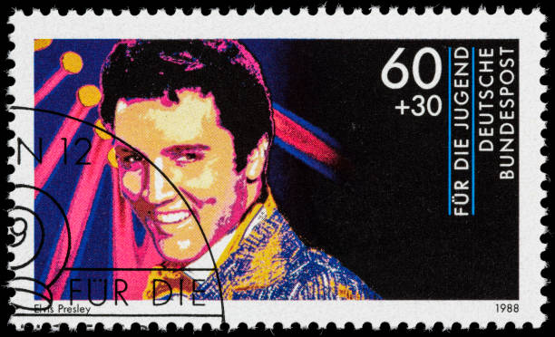 germany elvis presley postage stamp - elvis stock photos and pictures