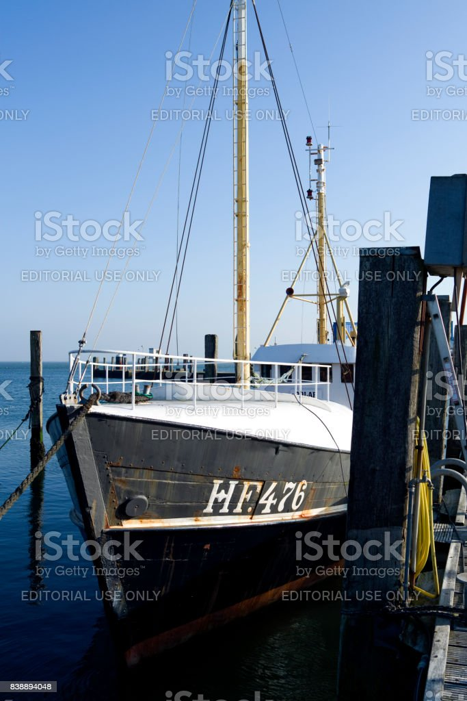 Germany: Fishing cutter in the harbor of Wyk on the Frisian island of Foehr stock photo