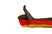 Germany flag painted on hand showing thumbs up