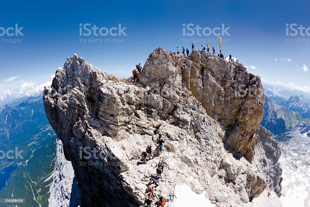 Germany, Group of hikers hiking on Zugspitze mountain stock photo