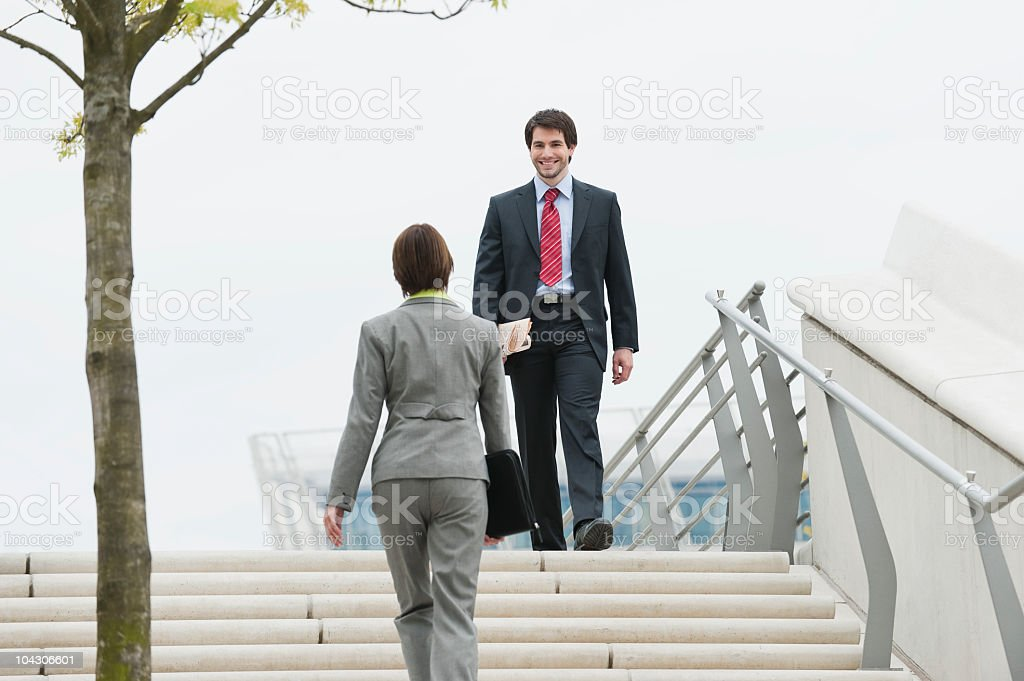 Germany, Hamburg, Business people at stairway royalty-free stock photo