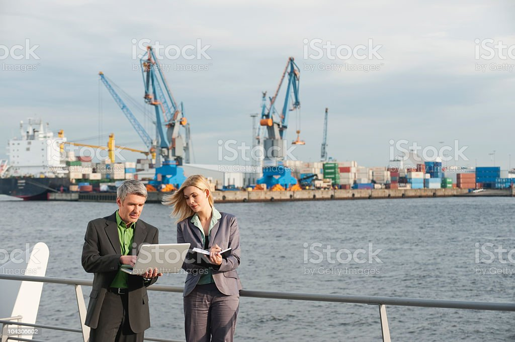 Germany, Hamburg, Business people working at harbour royalty-free stock photo