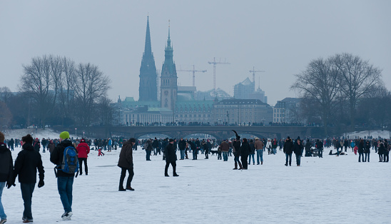 Germany, Hamburg, ice covered Aussenalster during winter
