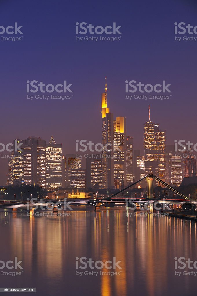 Germany, Hesse, Frankfurt, Skyline with bridge over Main River at dusk royalty-free stock photo
