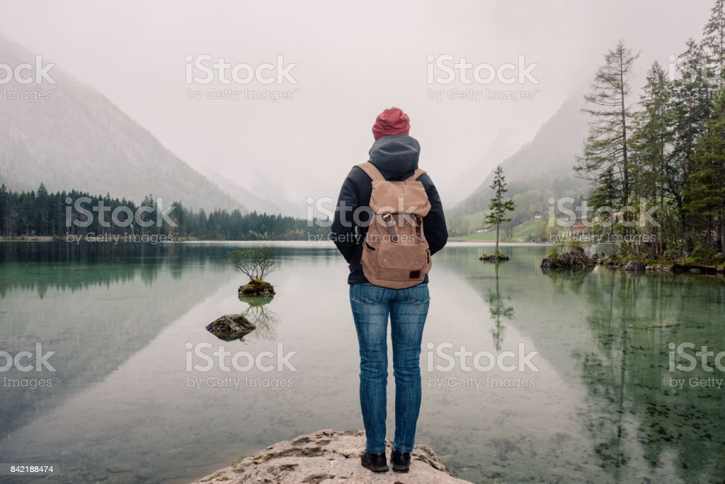 Germany. Lake Hintersee. Girl traveler with a backpack near a high mountain lake in the Alps-7 stock photo