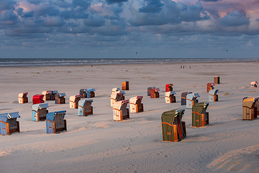 Germany, Lower Saxony, East Frisia, Juist, beach baskets in the evening light.