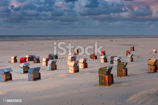 istock Germany, Lower Saxony, East Frisia, Juist, beach baskets in the evening light. 1158635900