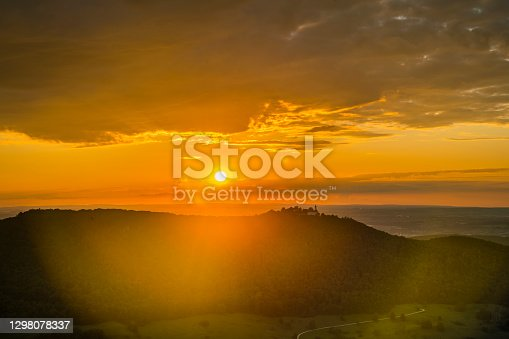 istock Germany, Magical aerial view above valley of swabian jura nature landscape at sunset with orange sky near stuttgart with view to castle teck 1298078337