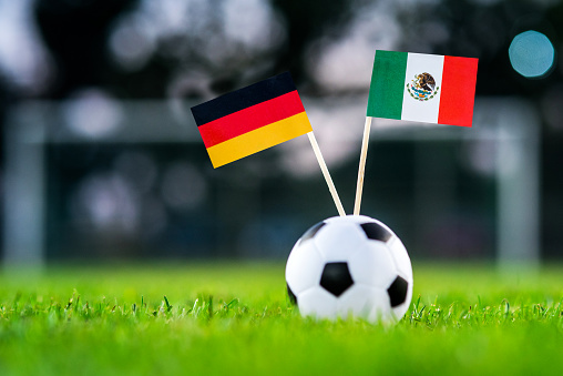 Germany - Mexico, Group F, Sunday, 17. June, Football, World Cup, Russia 2018, National Flags on green grass, white football ball on ground.