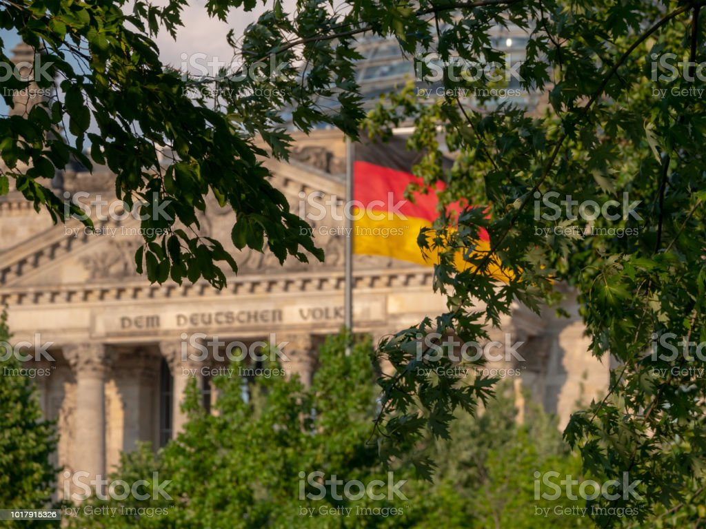 German Flag In Front of The Reichstag Building In Berlin, Germany
