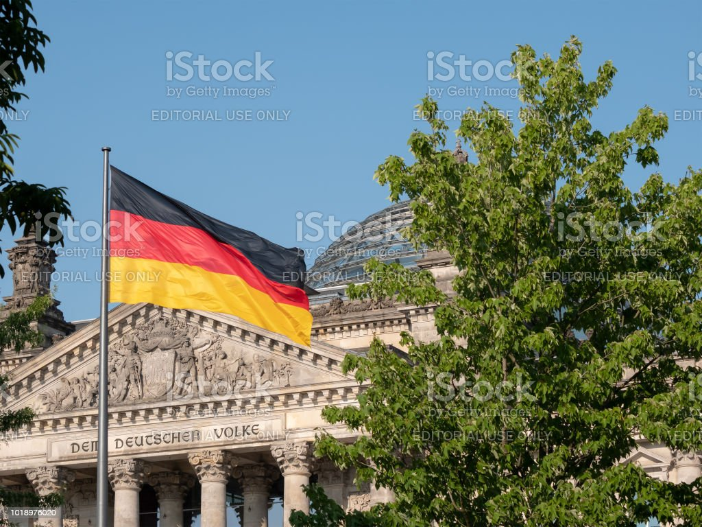 German Flag In Front of The Reichstag Building In Berlin, Germany...