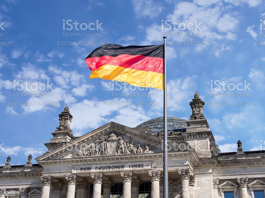 German Flag In Front of The Reichstag Building