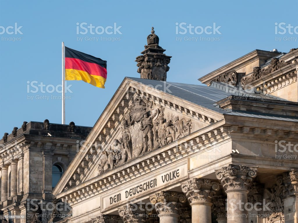 German Flag Upon The Reichstag Building In Berlin, Germany With...