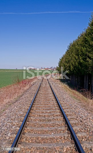View over a single-track railway line in the rural landscape near Reichstaedt on a sunny day in March 2019