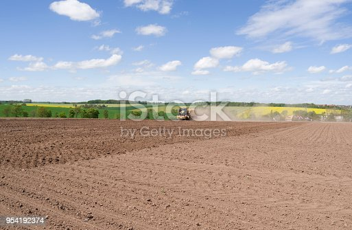 Self-propelled farmland injector with rotary harrow and crumbler roller on undeveloped arable land in Altenburg on a sunny day at the end of April
