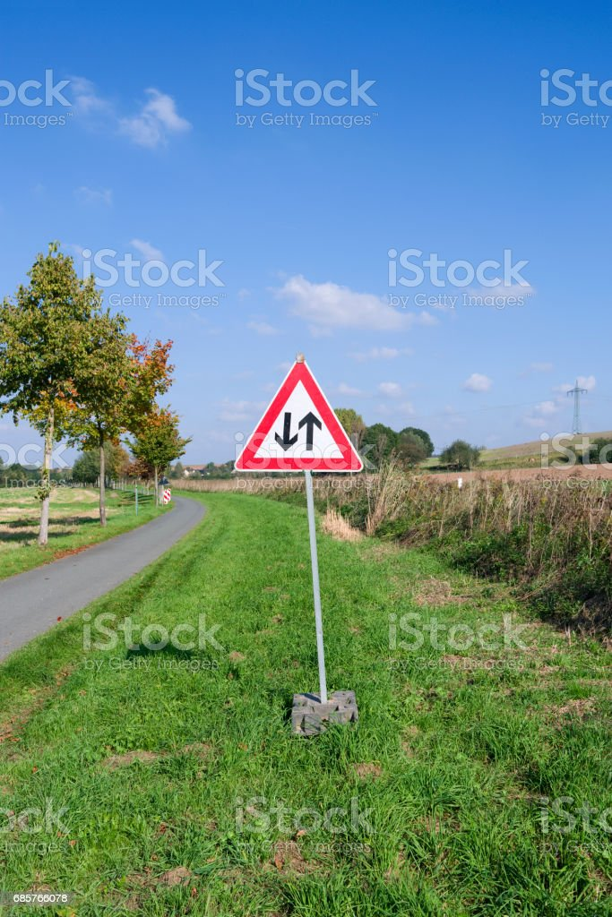 """Germany: Temporary warning sign """"Two way traffic ahead"""" stock photo"""