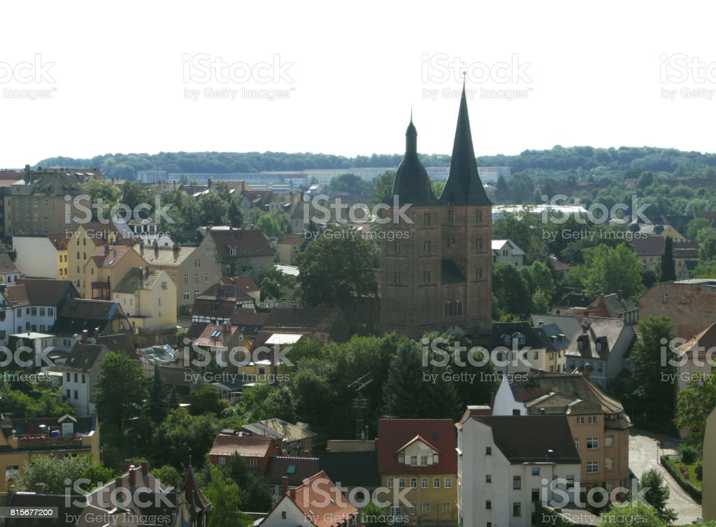 """Germany: View over the """"Red Spires"""", the landmark of Altenburg, to a typical GDR prefab estate at the edge of the urban forest stock photo"""