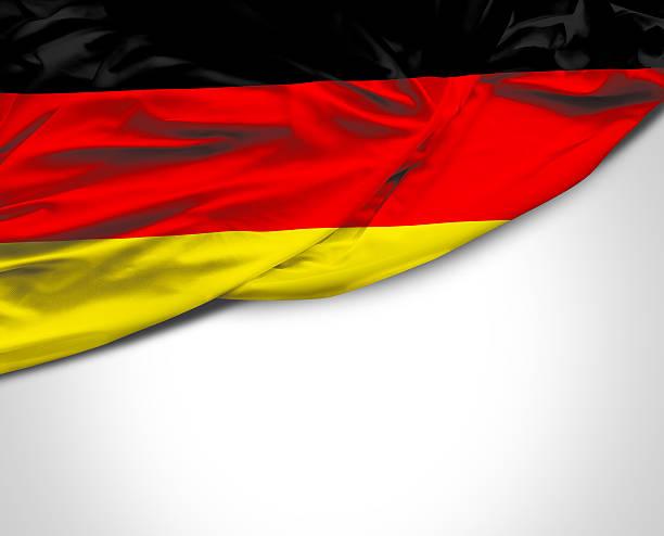 deutschland winken flagge auf weißem hintergrund - stoffe berlin stock-fotos und bilder