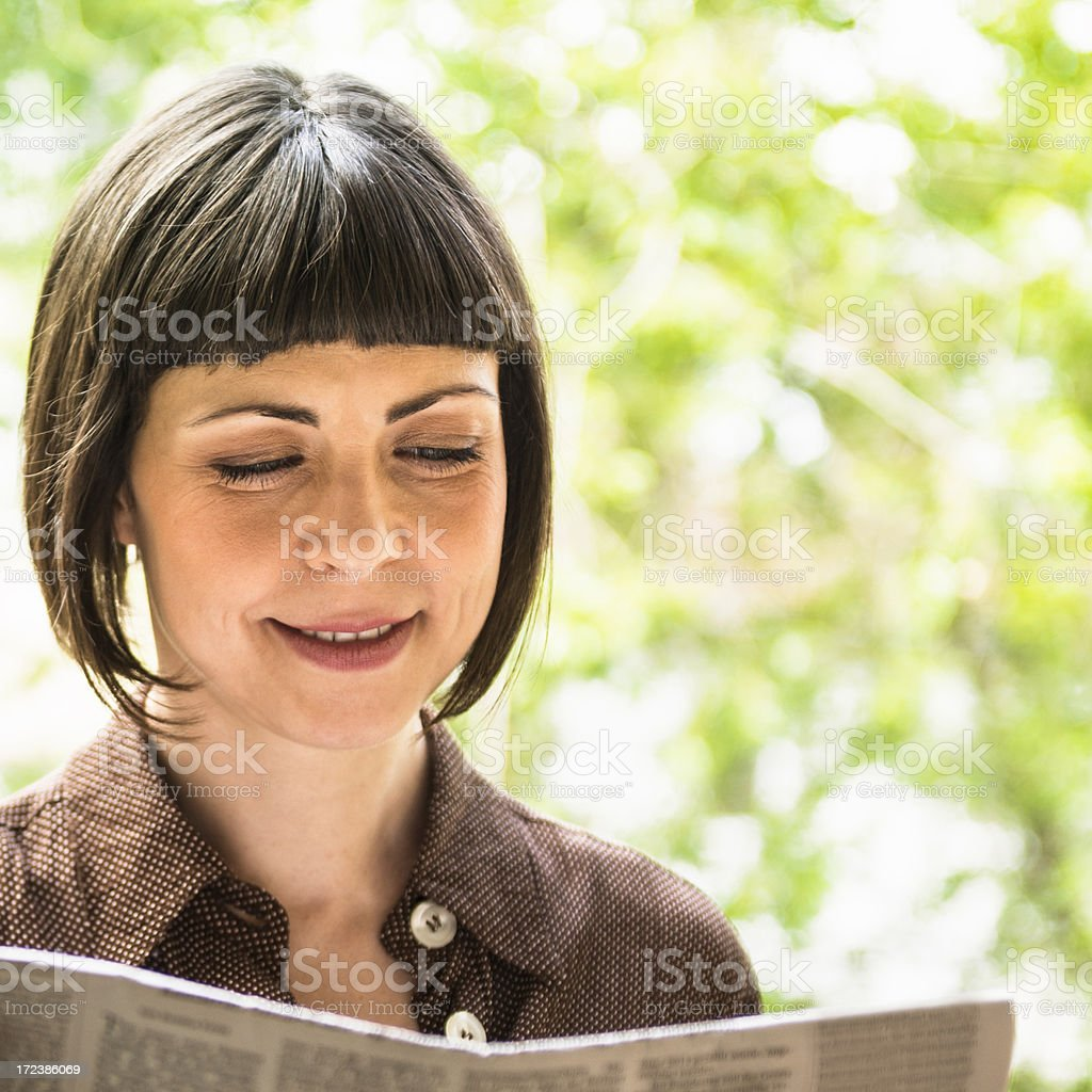 Germany woman reading a newspaper royalty-free stock photo