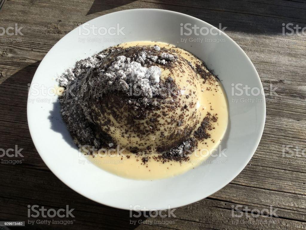 Germknödel with vanilla sauce and poppy seeds stock photo