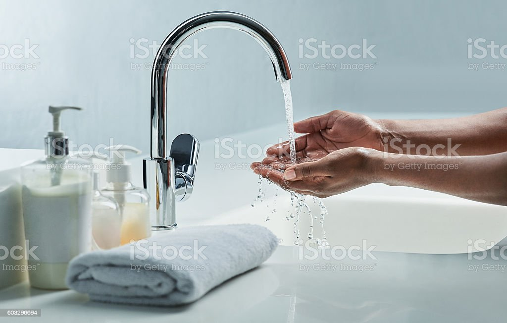 Germs and bacteria down the drain stock photo