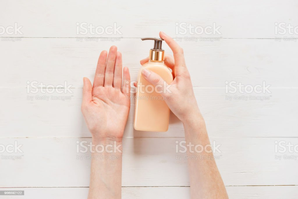 gesture of womans hand using hand sanitizer stock photo