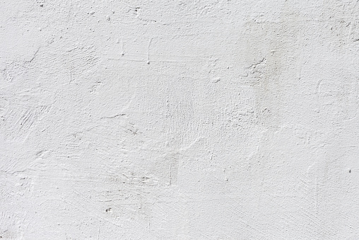 Gestures white painted concrete background