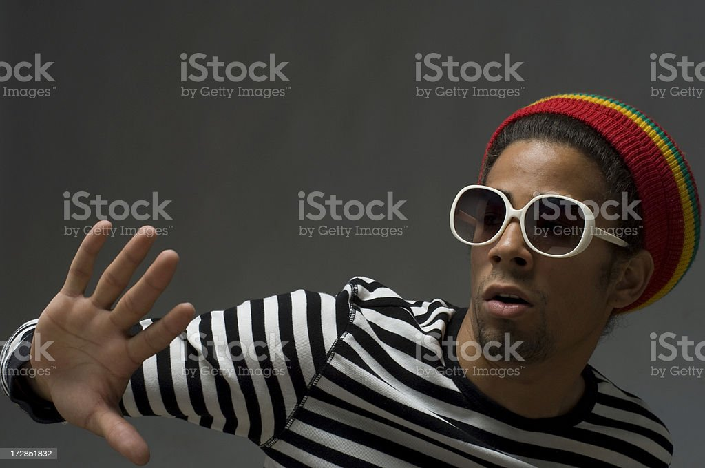 gesturing cool funky young man stock photo