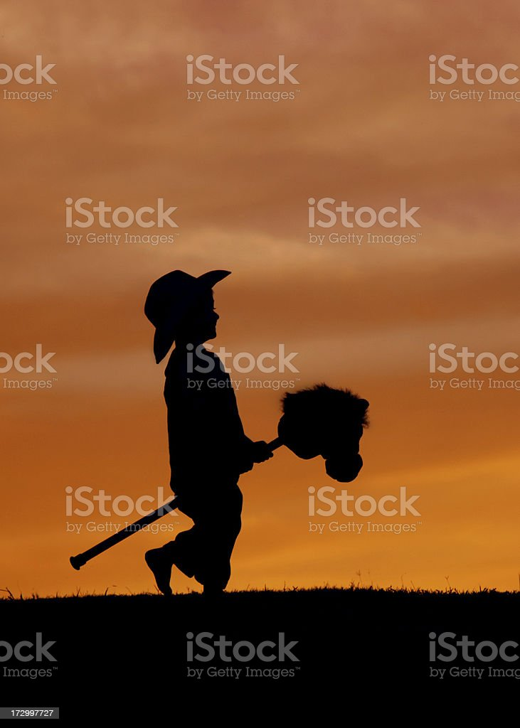 Get Along Little Cowboy royalty-free stock photo