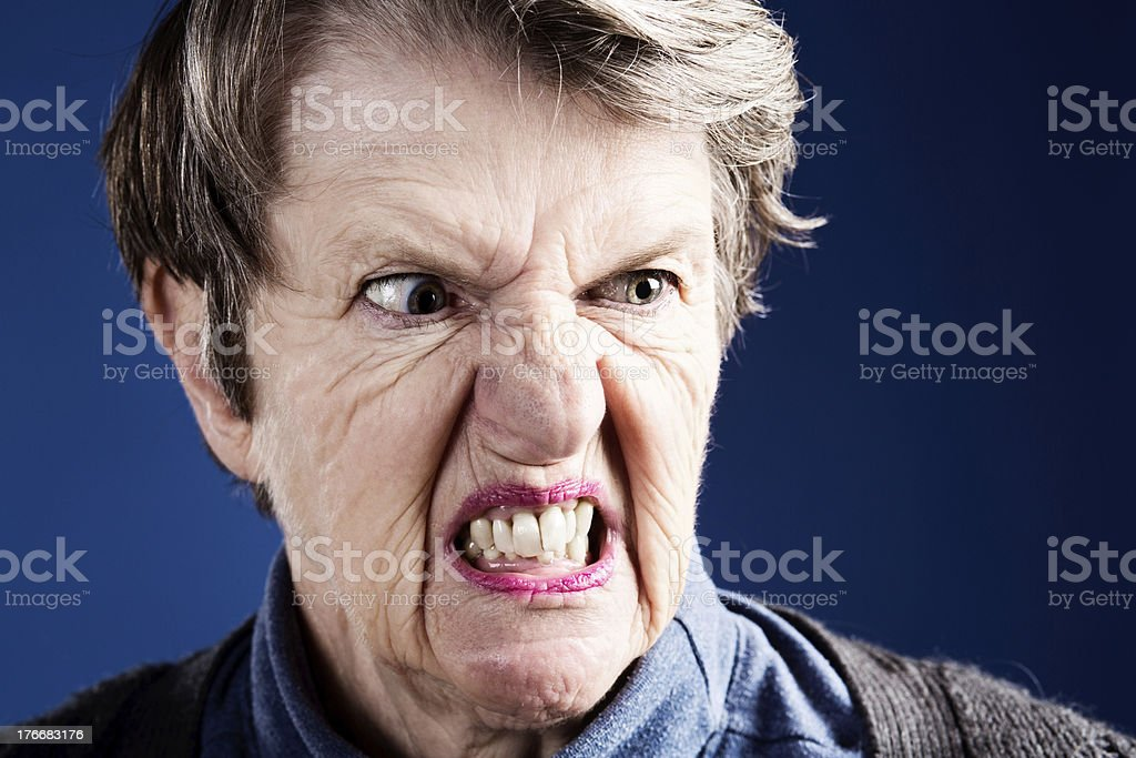 Get away from me! Angry, nervous old woman grimaces royalty-free stock photo