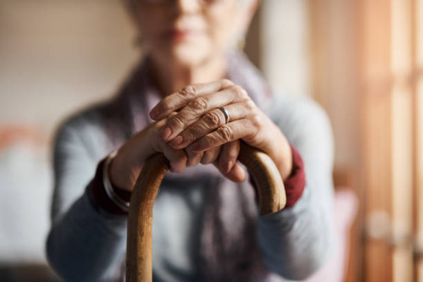 i get by with a little help from my cane - geriatrics stock pictures, royalty-free photos & images